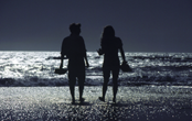 Couple at the beach, San Francisco Bay, CA (USA) /